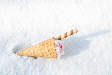 Foto de Waffle cone with ice cream on snow, space for text - Imagen libre de derechos