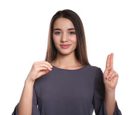 Photo pour Woman using sign language on white background - image libre de droit