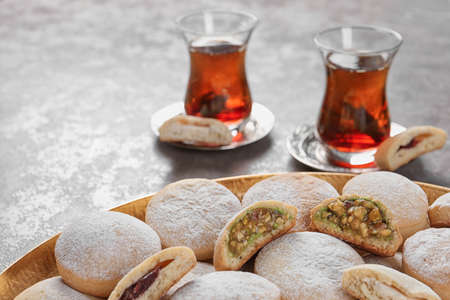 Photo for Traditional cookies for Islamic holidays and tea on table. Eid Mubarak - Royalty Free Image