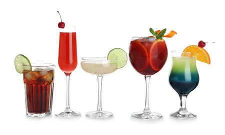 Foto de Glasses of traditional alcoholic cocktails on white background - Imagen libre de derechos