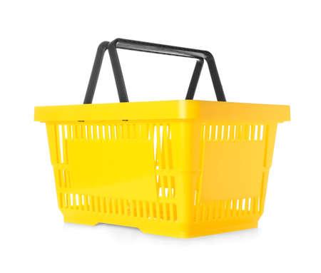 Foto de Color plastic shopping basket on white background - Imagen libre de derechos
