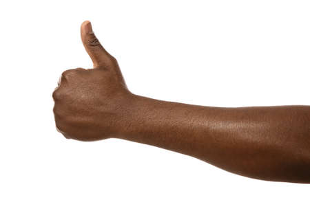 Photo for African-American man showing thumb up gesture on white background, closeup - Royalty Free Image