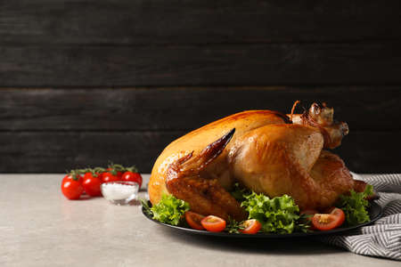 Photo for Platter of cooked turkey with garnish on table. Space for text - Royalty Free Image