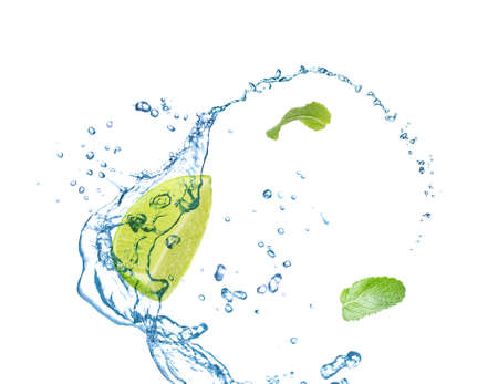 Foto de Slice of juicy lime, fresh mint and splashing cold water on white background - Imagen libre de derechos