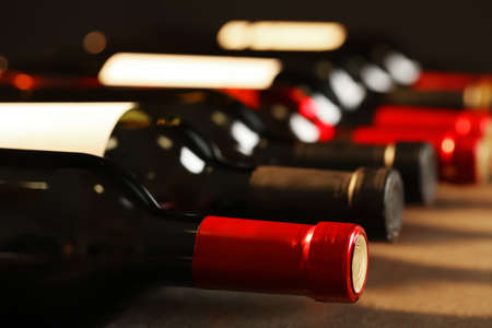 Photo for Bottles of different wines, closeup. Expensive collection - Royalty Free Image