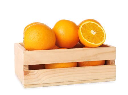 Wooden crate full of fresh oranges on white background