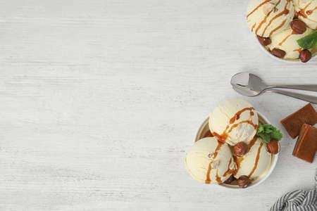 Foto de Flat lay composition with delicious ice cream on wooden table. Space for text - Imagen libre de derechos