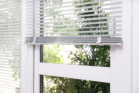 Photo pour Open white horizontal window blinds, closeup view - image libre de droit