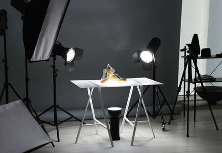 Photo pour Professional photography equipment prepared for shooting stylish shoes in studio - image libre de droit