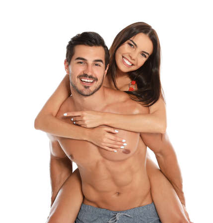 Photo for Young attractive couple in beachwear on white background - Royalty Free Image