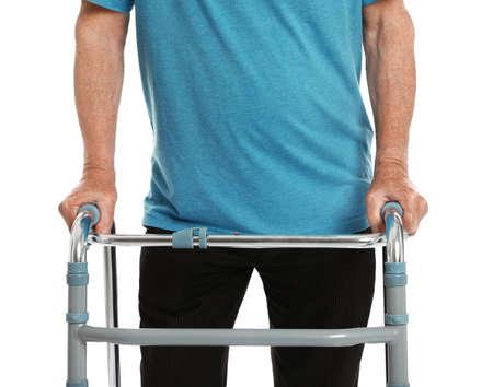 Foto de Elderly man using walking frame isolated on white, closeup - Imagen libre de derechos