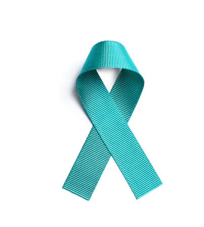 Foto de Teal awareness ribbon on white background, top view. Symbol of social and medical issues - Imagen libre de derechos