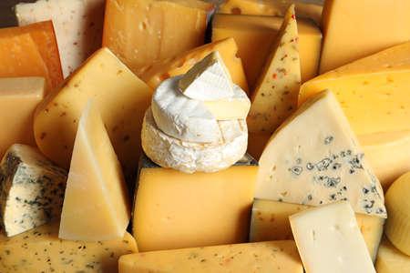 Photo pour Different types of delicious cheese as background, closeup - image libre de droit