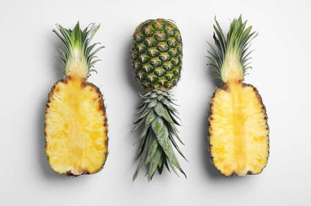 Foto de Tasty ripe pineapples on white background, top view - Imagen libre de derechos