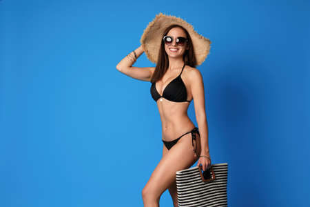 Photo for Pretty sexy woman with slim body in stylish  black bikini on blue background, space for text - Royalty Free Image
