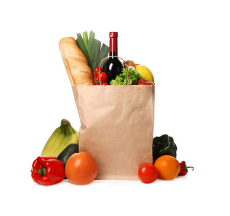 Foto de Paper bag with groceries on white background - Imagen libre de derechos
