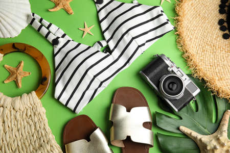 Photo for Flat lay composition with beach objects on green background - Royalty Free Image