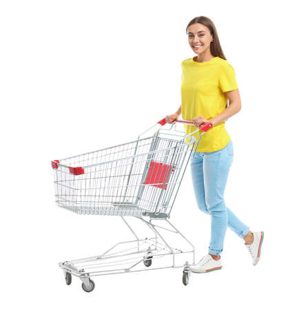 Photo pour Young woman with empty shopping cart on white background - image libre de droit