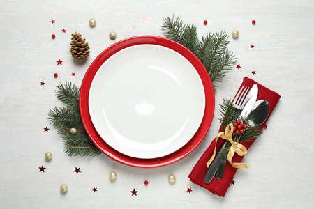 Foto de Christmas table setting on white background, flat lay - Imagen libre de derechos