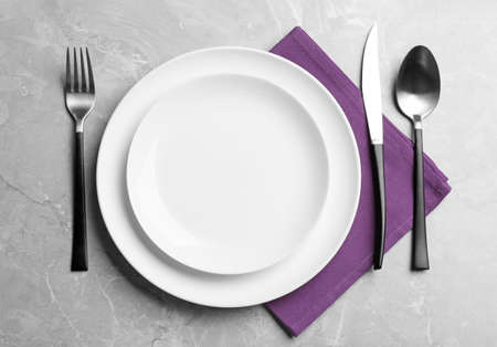 Photo for Elegant table setting on grey marble background, flat lay - Royalty Free Image