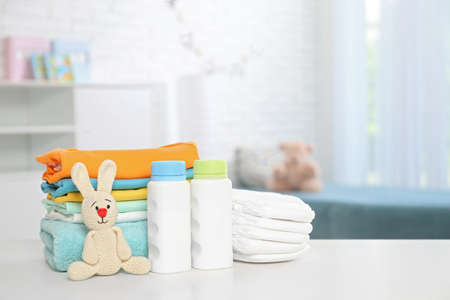 Foto de Baby accessories on table in nursery room. Space for text - Imagen libre de derechos