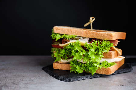 Photo for Yummy sandwich with bacon and chicken on table - Royalty Free Image