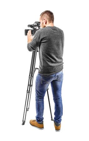 Foto de Video camera operator isolated on a white background - Imagen libre de derechos