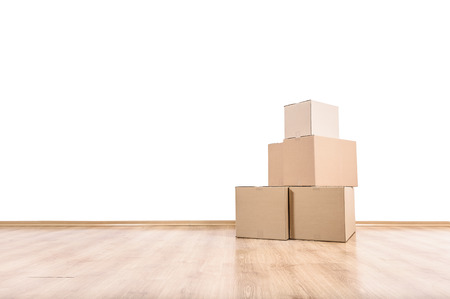 Foto per Empty room with boxes on the floor. - Immagine Royalty Free