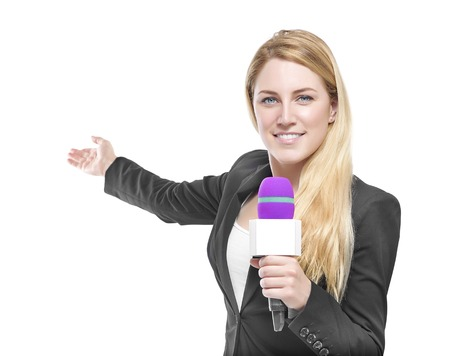 Photo for Attractive blonde TV presenter holding a microphone and points to an object. Isolated on white background. - Royalty Free Image