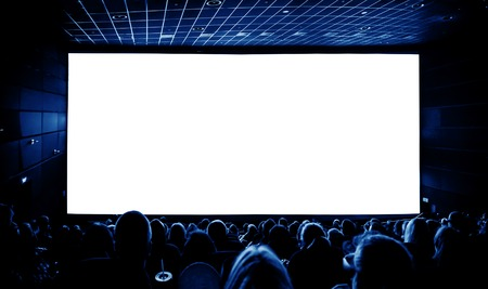 Foto de Cinema. The audience in 3D glasses watching a movie. A white screen for your image. - Imagen libre de derechos