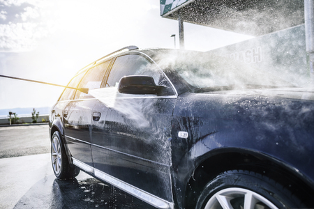 Photo for High-pressure washing car outdoors. Car washing under the open sky. - Royalty Free Image