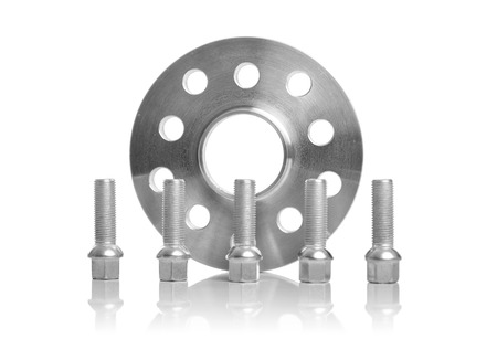 Photo pour Spacers to increase the wheelbase of the car on a light background. - image libre de droit