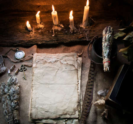 Photo pour Magic fairytale table in the hut with window to the garden with open ancient book and burning candles - image libre de droit