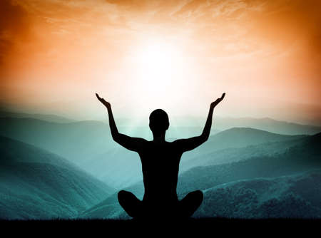 Photo pour Yoga and meditation. Silhouette of man on the mountain. - image libre de droit