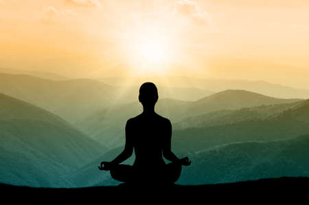 Photo for Yoga silhouette on the mountain in sunrays. the dawn sun - Royalty Free Image