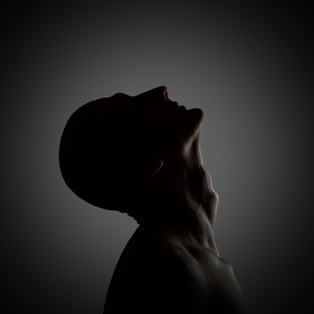Photo for Creepy profile of the mysterious man. Low-key lighting - Royalty Free Image