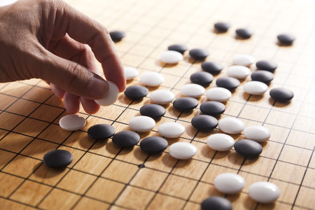 Foto de Go. Traditional asian strategy board game. - Imagen libre de derechos