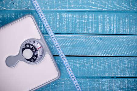 Foto de Weight loss concept showing a bathroom scales and a tape measure - Imagen libre de derechos