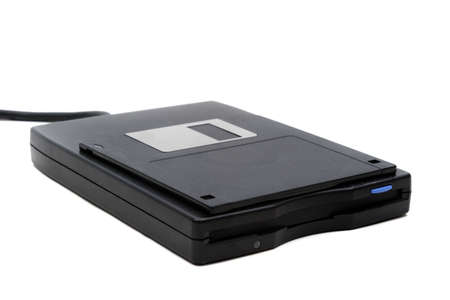 Photo pour A 3.5 floppy disk and drive isolated on a white background - image libre de droit