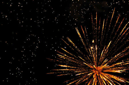 Golden festive fireworks in colorful shades of yellow and orange