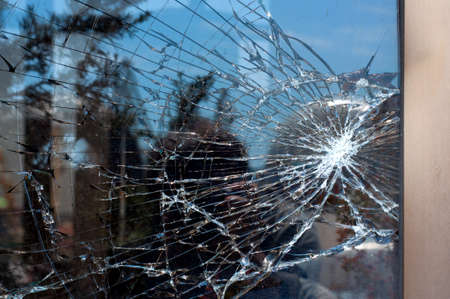 Photo for Broken Glass with outdoor street reflection. Closeup. - Royalty Free Image