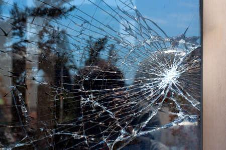 Foto de Broken Glass with outdoor street reflection. Closeup. - Imagen libre de derechos
