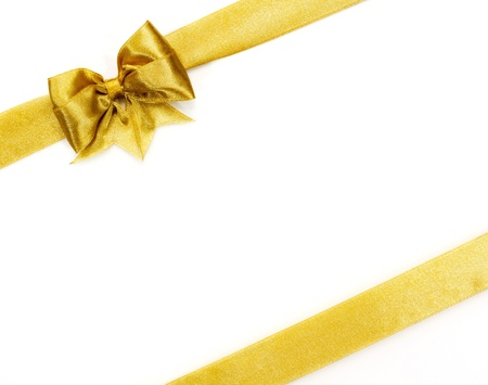 Golden satin gift bow  Ribbon on white