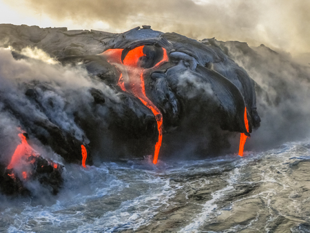 Photo pour Kilauea Volcano in Hawaii Volcanoes National Park, also known Kilauea Smile because from 2016 seems to smile, erupting lava into Pacific Ocean, Big Island. Scenic sea view by boat. - image libre de droit