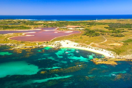Foto de Aerial view of Pink lake and coastline of Rottnest Island in Australia. Scenic flight over famous tourist destination of Western Australia. Rottnest Island is located near Fremantle and Perth. - Imagen libre de derechos