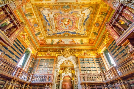 Foto de Coimbra, Portugal - August 14, 2017: University library in Coimbra, the Europes oldest university founded in 1290. Unesco World Heritage Site and most important tourist attraction in Coimbra. - Imagen libre de derechos