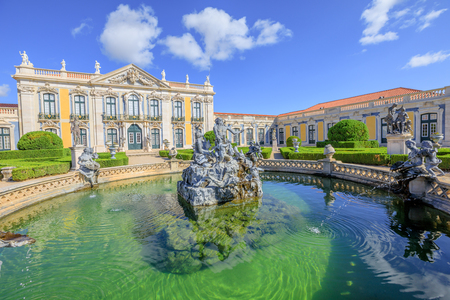 Photo pour Baroque facade of Queluz National Palace and Neptune Fountain in Sintra, Lisbon district. Defined as the Versailles of Portugal, the Royal Palace of Queluz was used as a fun place for the royal family - image libre de droit