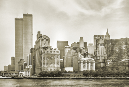 Foto de New York City skyline from NJ with World Trade Center featured as landmark of Twin Towers, destroyed in September 11, 2001. Sepia background, vintage style. Lower Manhattan in NYC, United States. - Imagen libre de derechos