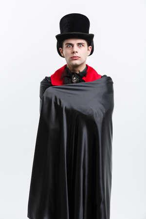 Photo for Vampire Halloween Concept - Portrait of caucasian vampire sleeping in halloween dracula costume. - Royalty Free Image