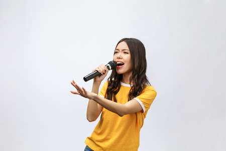 Photo for beautiful stylish woman singing karaoke isolated over white background. - Royalty Free Image
